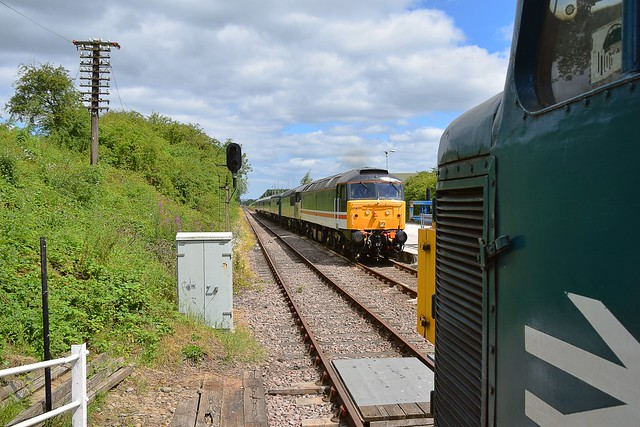 47828 passes the British Gypsumunloading facility as it approaches Rushcliffe Halt, with a service to Loughborough. 45060 is waiting in the station for the road. Great Central Railway North Diesel Gala. 02 07 2017