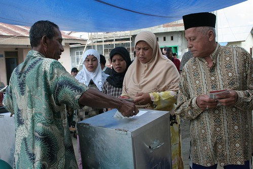 Locals preparing to vote at a local voting poll | by USAID Indonesia