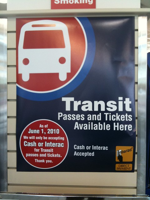 """Transit Passes and Tickets Available Here"" sign at London Drugs on Cambie and Broadway"