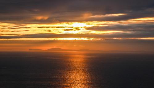 andygocher canon100d sigma18250 europe uk wales westwales southwales pembrokeshire coastalpath sea stbridesbay clouds water sun sunset orange