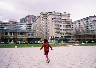 A young girl walks through a city square in Sarajevo | by World Bank Photo Collection