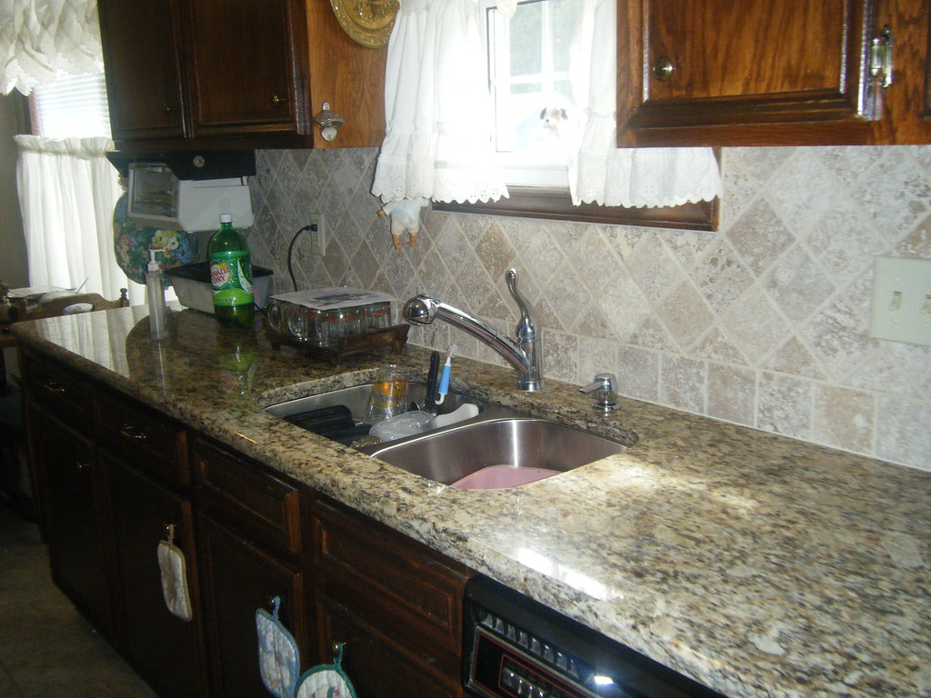 Santa Cecilia Granite Countertops With Tile Backsplash In