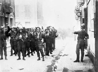 Canadian prisoners of war being lead through Dieppe by German soldiers / Prisonniers de guerre canadiens