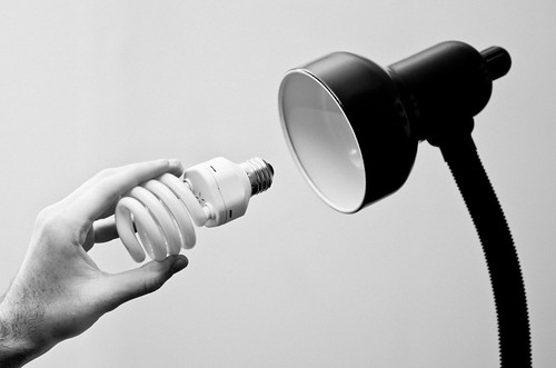 light bw lamp lightbulb bulb neck hand fingers fluorescent compact cfl ridges ds246
