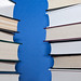 Two parallel stacks of books on blue background by Horia Varlan