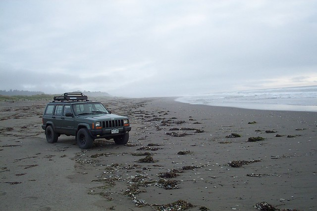 JEEP ON FOGGY COAST