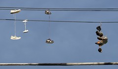 Photograph: Shoes on a wire 2
