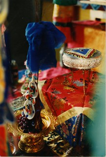 Torma, Ritual cake and sand mandala on a silver mandala offering plate, with indigo blue cloth, silk fabric, in front of the main shrine, semi-wrathful deity initiation setup, Tharlam Monastery of Tibetan Buddhism, Boudha, Kathmandu, Nepal, 1990
