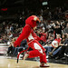 Benny the Bull kicks a ball into the crowd
