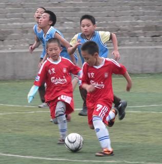 dribbling Soccer Beijing | by http://klarititemplateshop.com/