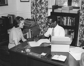 Photograph of a National Archives Consultant Helping a Researcher | by The U.S. National Archives