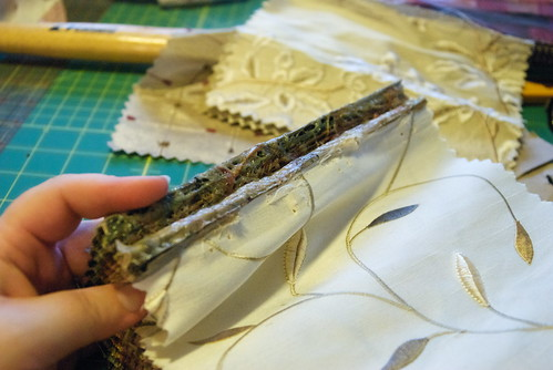 Once you pry out the staples, well, you still can't salvage everything; the fabrics are glued together roughly and unevenly with industrial-strength glue.