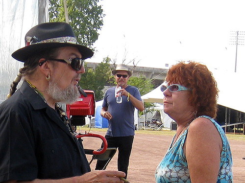 Dr John chats with a friend backstage with Jimmy Carpenter in the background