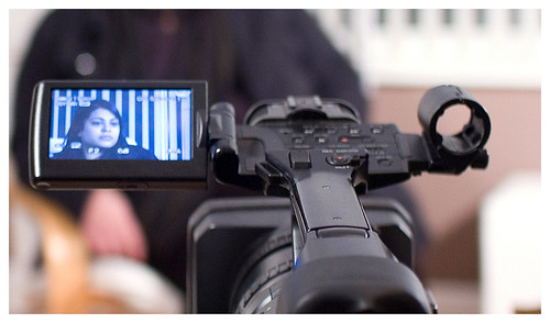 Camera operator setting up the video camera
