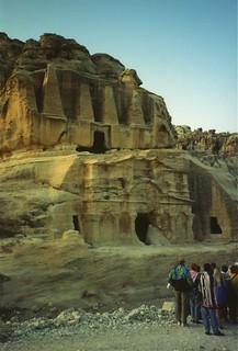 Tourists admiring the 'Obelisk Tomb' at Petra, Jordan