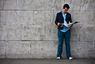 Reading A Newspaper By A Wall | by garryknight