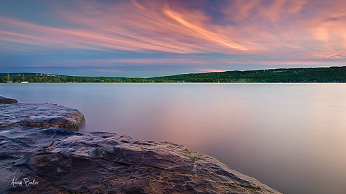 longexposure sunset summer orange lake ny water yellow clouds canon landscape rocks warm purple vivid upstate panoramic ithaca portfolio cayuga tompkins cpl 1740l eastshorepark gnd adambaker 5dmarkii