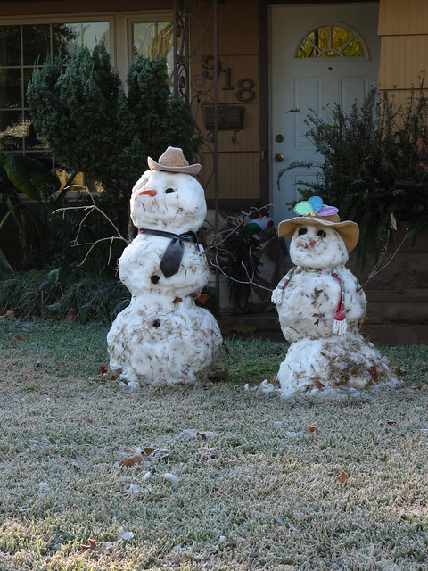 Houston Texas Winter Snow Two snowmen standing in yard  December 4 2009 during and after the snow fall  IMG_2241