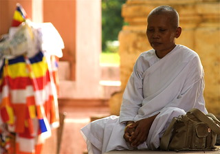 A Buddhist Nun Meditating At The Mahabodhi Temple | by El-Branden Brazil
