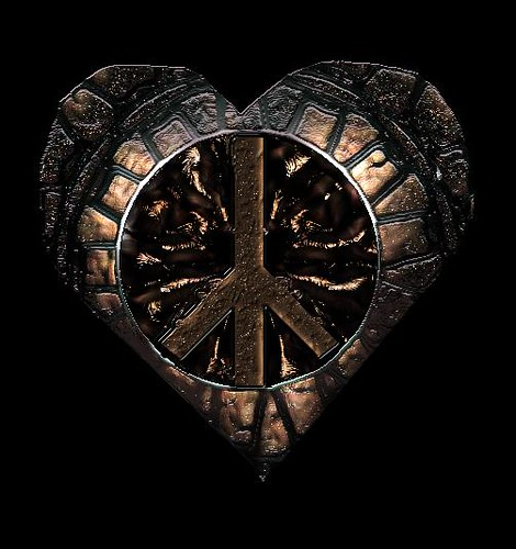 A metal heart with the peace symbol inside