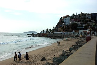 Strolling down the beach with surf boards, hanging out under an umbrella, South Mazatlan beach in the afternoon, beyond the seawall, Mexico | by Wonderlane