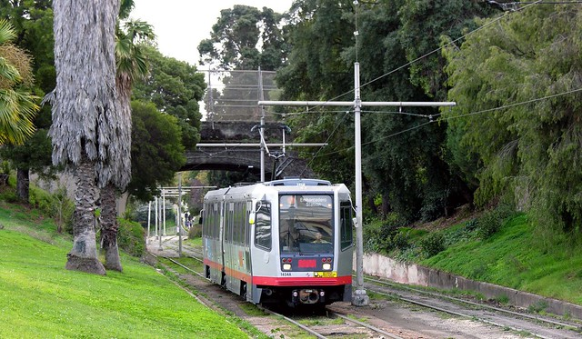 SF Muni Line J - 1454 in Mission Dolores Park approaching  18th St