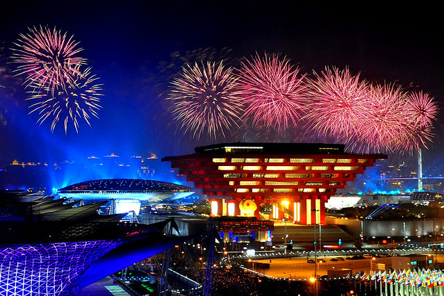 Fireworks explode over the Expo Performance Centre (L) and the China pavilion (R) during the opening ceremony of the World