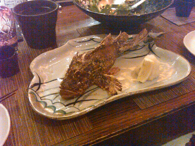 Trying grilled scorpion fish. Tasty and salty :)