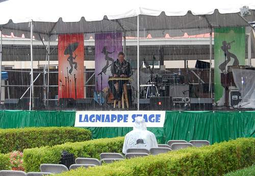 Even the torrential rain couldn't keep one die-hard fan from listening to Spencer Bohren on the Lagniappe Stage