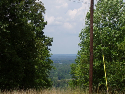 A cut in the trees reveals the vista from the top of Woodall Mountain.