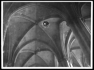 Showing the hole in the roof through which the first shell to strike the Cathedral entered   by National Library of Scotland