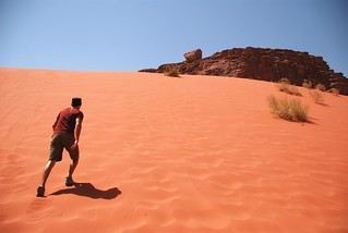 fighting an uphill battle, wadi rum | by hopemeng