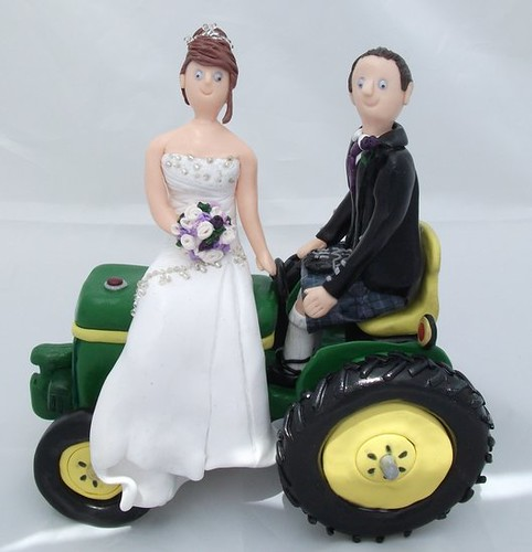 Wedding Cake Toppers On Tractor A Bride A Groom And Their Flickr