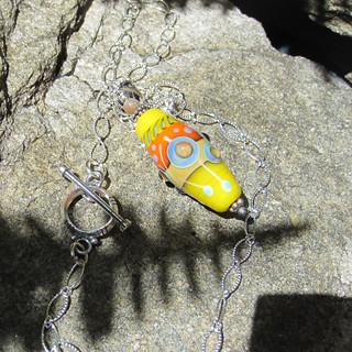 Yellow lampwork pendant