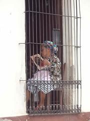Mujer con rejas - Woman reading; Sushitoto, Cuscatlán, El Salvador