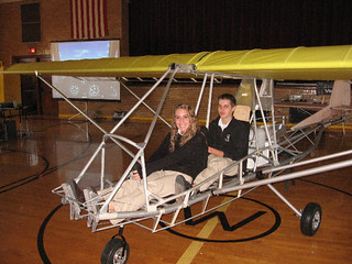 "Physics students ""at the controls"" of the plane during a preassembly of the plane at the school's open house. 