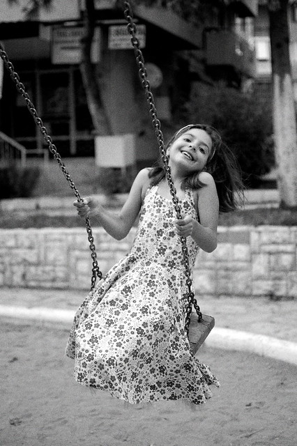 Little cousin enjoying the swing