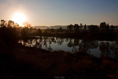 africa sunset red sky sun reflection nature water canon southafrica scenery dusk dam smoke pretoria gauteng 450d canon450d hannessteyn eosdigitalrebelxsi canonefs18200mmf3556is mahemplayground