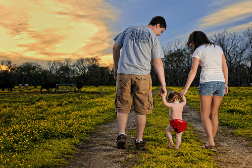 family flowers sunset portrait sky baby girl field clouds mom necklace couple dad texas child tx father mother oneyearold brazoria sb900 bluecityphotographycom