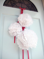 Christmas pom-poms decorating my new blue front door | by ishandchi