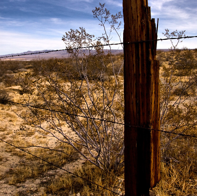Some fence out in the middle of the desert, feels like nowhere but I know I'm somewhere