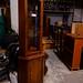 Tall mahogany slim corner glass display unit E160