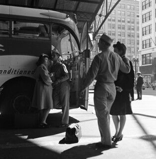 Esther Bubley: Soldiers with their girls in front of the Greyhound bus, Indianapolis, 1943
