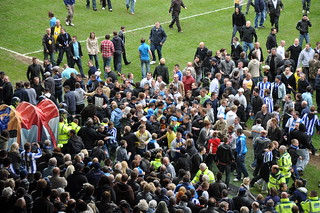 Sheffield Wednesday fans rush the players' tunnel at Hillsborough in pursuit of Crystal Palace's Clint Hill   by Ben Sutherland