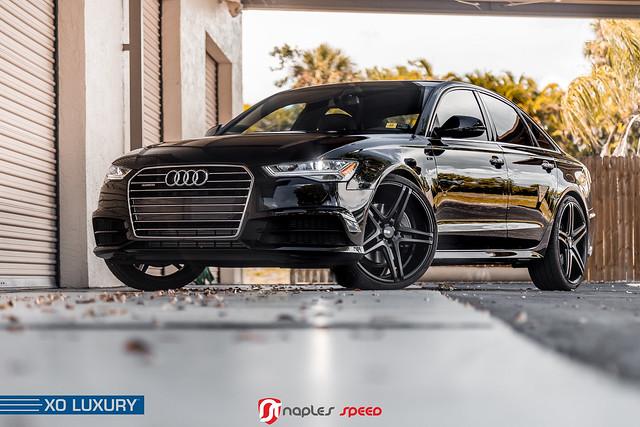 Audi A6 Black with XO Luxury Caracas