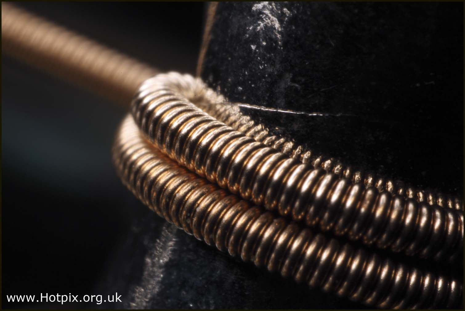 extreme,macro,guitar,string,gold,tuning,metal,coils,coiled,20mm,OM,olympus,close,up,closer,this photo rocks,extrememacro,stillife,stilllife,still,life,abstract,hotpix!