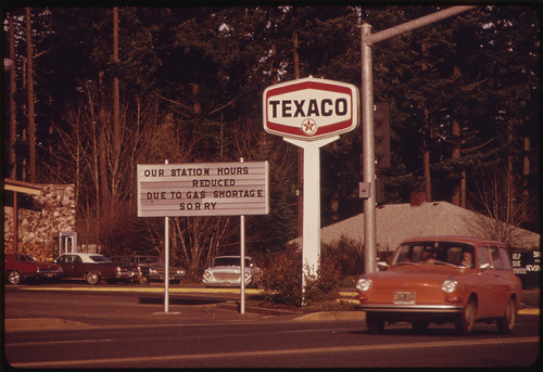 Fuel Shortage in the Pacific Northwest Resulted in a Sign About Shorter Hours Like This at a Gasoline Station at Oak Grove Oregon. Most Stations Reduced Their Hours and Closed on Sundays 12/1973 | by The U.S. National Archives