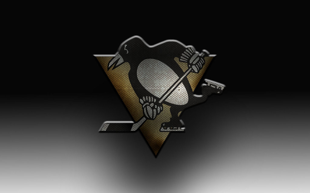 Pittsburgh Penguins Logo Wallpaper Featuring A Penguins Lo
