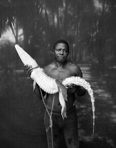 Abdou Ndong & rescued crocodile, Makasutu, The Gambia, West Africa