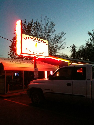 sunset sign neon texas huntsville piercing tattooparlour voodootattoo gowalla:spot=813597 foursquare:venue=1536299